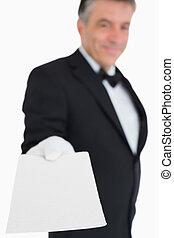 Waiter giving a card