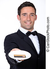 Waiter giving back credit card
