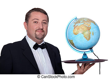 Waiter holding a globe on his tray