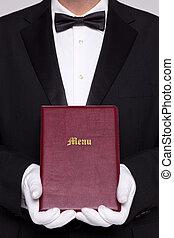 Waiter holding a Menu folder in a restaurant.