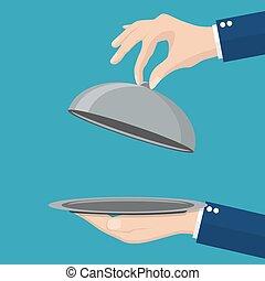 Waiter holding an empty cloche