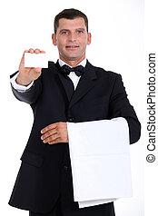Waiter holding business card