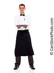waiter holding empty tray