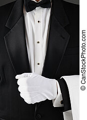 Waiter Holding Lapel - Closeup of a waiter wearing a tuxedo...