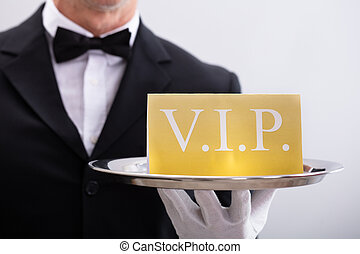 Waiter Holding Plate With Vip Banner