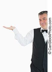 Waiter holding something