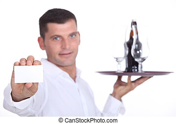 Waiter holding tray and business card