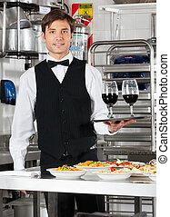 Waiter Holding Wineglasses on Tray