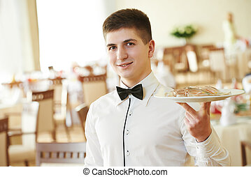 waiter man with tray at restaurant - young male waiter with...