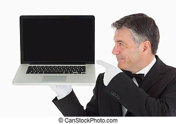 Waiter pointing to laptop - Waiter holding and pointing to...