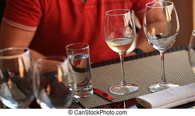 Waiter Serves Banquet Table. Couple in a restaurant....