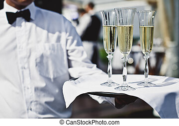 Waiter serving champagne at festive event