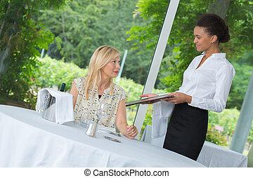 waiter serving happy elegant woman