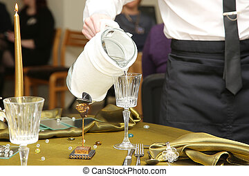 waiter serving mineral water