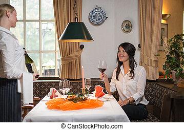 Waiter serving wine in a fine restaurant