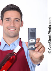 Waiter showing mobile phone