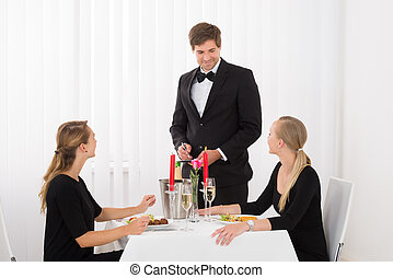 Waiter Taking An Order From Female Friends