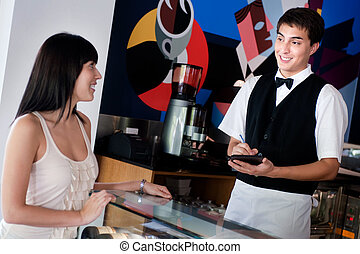 Waiter Taking Order - A young and attractive waiter taking...
