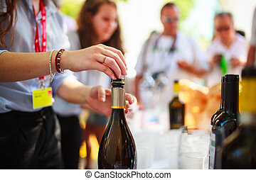 Waiter uncorked bottle of wine - Waiter uncorked bottle of ...