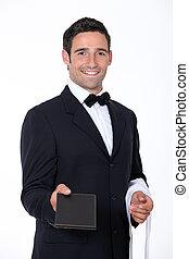 Waiter with a menu