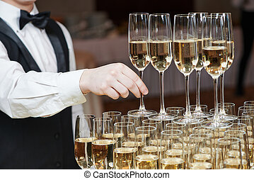 Waiter with glass of champagne - Waiter hand with glass of...