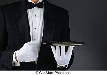 Waiter With Silver Tray - Closeup of a tuxedo wearing waiter...