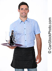 Waiter with tray and bottle of beer