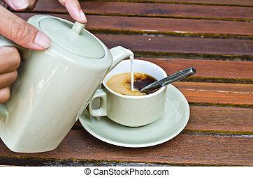 waiters hand serve coffee