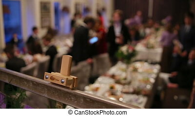 Waiters serving table in a wedding  ceremony for guests and a bride and her groom.