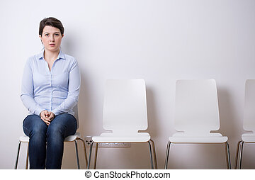 Waiting for a job interview - Young and attractive woman...