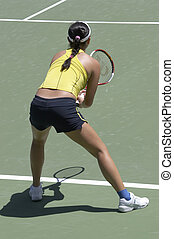 Waiting For a Serve - Tennis player waiting for a serve