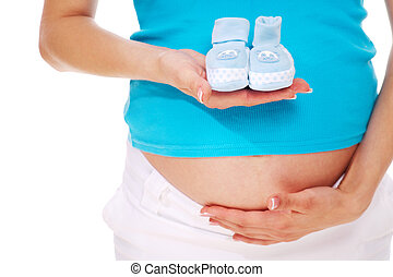 Waiting for baby - Close-up of pregnant woman holding blue ...