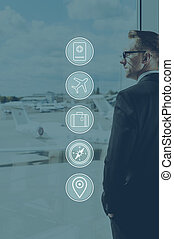 Waiting for his flight. Digitally composed icon set over a picture of businessman standing near window in airport