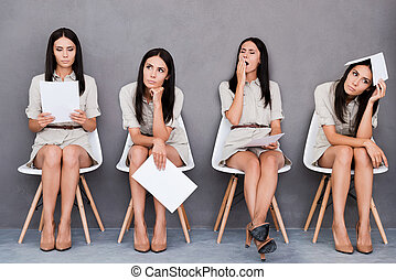 Waiting for interview. Digital composite of young businesswoman expressing different emotions while holding paper and sitting at the chair against grey background