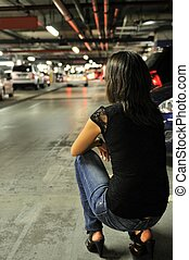 Waiting for nobody in underground parking place - Young...