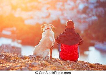 Waiting for sun - Enjoying sun. Pensive young man sitting on...