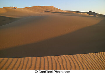 Waiting for sunset on the immense sand dune of Huacachina, Ica, Peru, South America