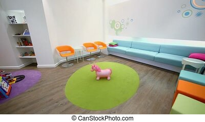 Waiting hall with furniture and toys in dental clinic