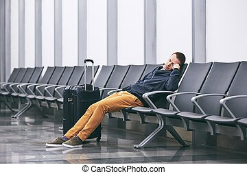 Waiting in airport terminal