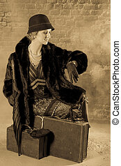 Vintage woman in twenties style waiting for the train