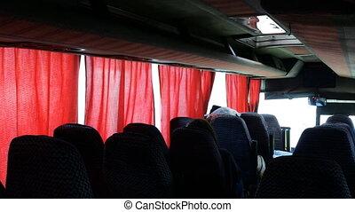 waiting passengers. Interior of public bus in India