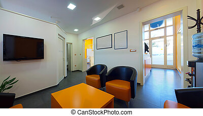 Waiting room. Interior of a dental clinic in orange and...