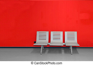 Waiting room - chairs against a red wall