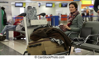 Waiting room - Woman sitting in airport lounge