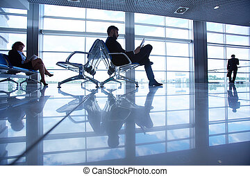 Waiting room with passengers in the airport