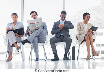 Waiting room with business people