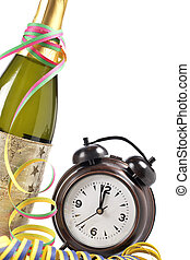 Waiting the New Year with champagne bottle and clock. ...