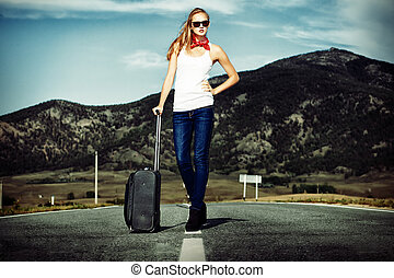 waiting woman - Attractive young woman hitchhiking along a ...