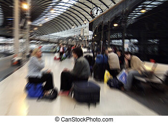 Waiting - Zoom blurred image of people waiting for trains on...