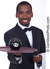 Waitor holding piggy bank